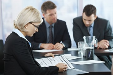 Professional checking documents at meeting