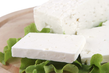 feta cheese on wooden plate