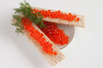 Caviar of a salmon on a saucer and small loafs with caviar
