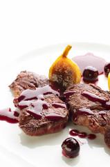 Deer steak with cranberries sauce