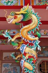 dragon statue on pillar of joss house, Borabue, Mahasarakam