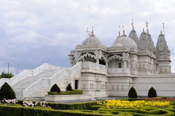 entrance and beautiful garden of hindu temple
