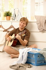 Guy with guitar and laundry