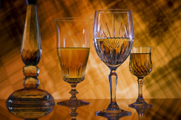 Wine glasses on orange grunge background