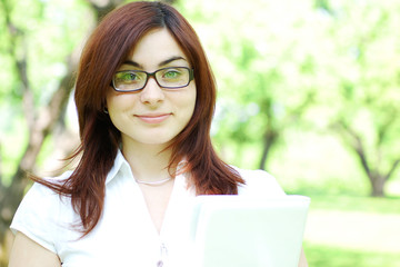 Young business woman in the park