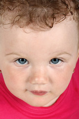 Detailed portrait of baby girl looking up at camera