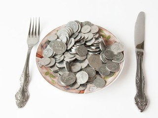 plate of silver coins over white