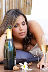lonely  Latin girl with champagne