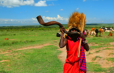 Masai warrior playing traditional horn