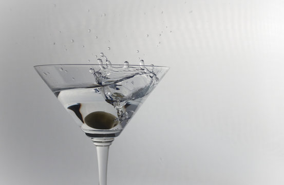 Olive spashing into a Martini