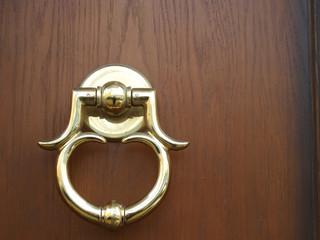 Golden round door knocker