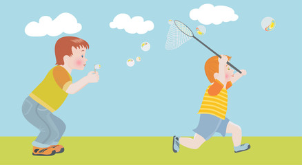 The child cheerfully catches a net soap bubbles