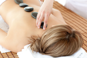 Relaxed woman having a stone therapy