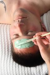 man getting a facial, close-up
