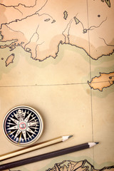 Compass and pencils on the map