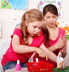 Children  with teacher  in play room.