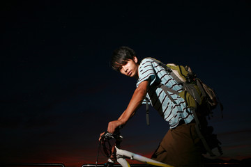 young asian man with bike