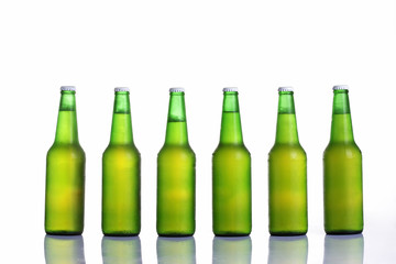 Beer in bottle on a white background .