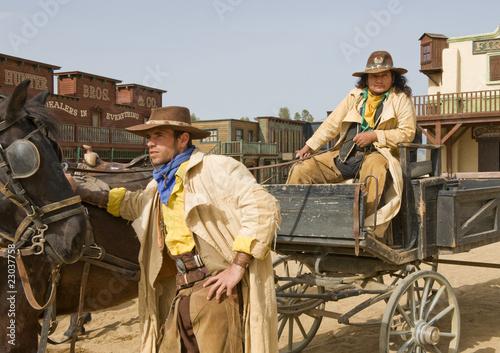 Wall mural Cowboys waiting by a wagon
