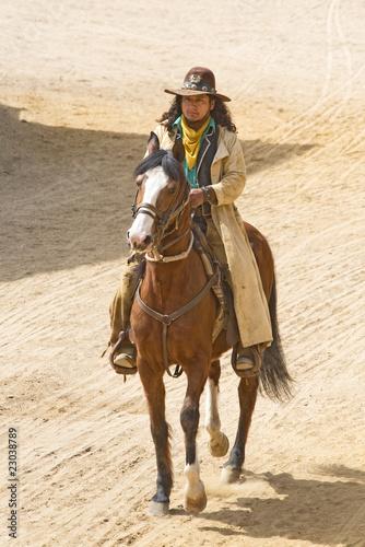 Wall mural Cowboy Bandit rides into town