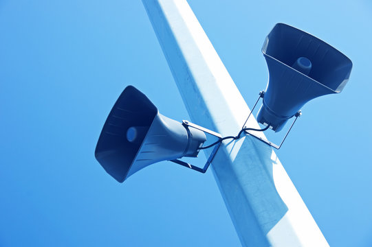 loudspeakers on a blue sky background