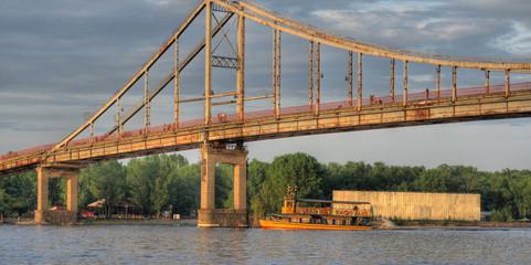 Motorboat under a bridge