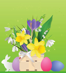 Easter basket with flowers and rabbit