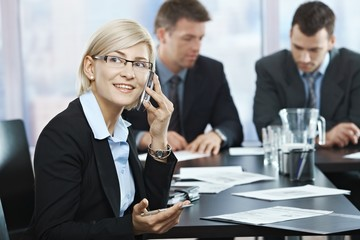 Businesswoman on phone at meeting