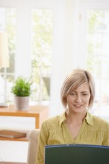 Portrait of woman looking at laptop