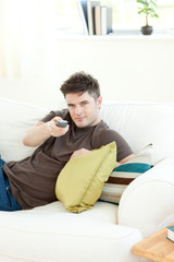 Self-assured man is relaxing