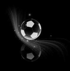 ballon de football refleté sur fond noir