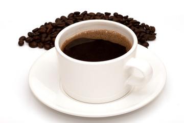 Black coffee in mug and coffee beans