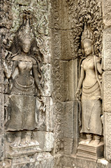Girls on the all of Bayon temple, Angkor, Cambodia