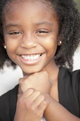 Headshot of a black child smiling
