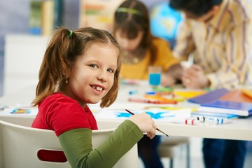 Elementary age schoolgirl painting