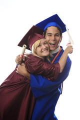 asian man and blond woman graduates in cap and gown