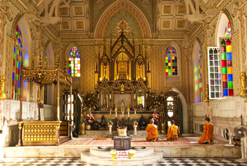 Monks are praying Buddha image in Buddhist church, Ayudhya, Thai