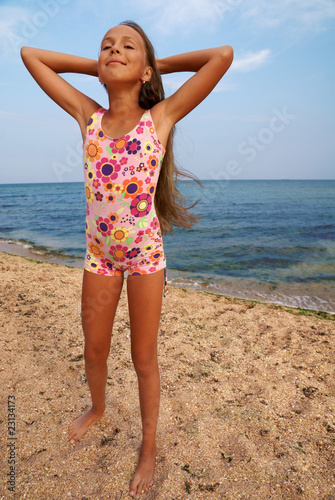 Young teen nudists at beach