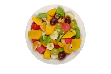 Tropical fruit salad on white plate