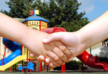 children shaking hands