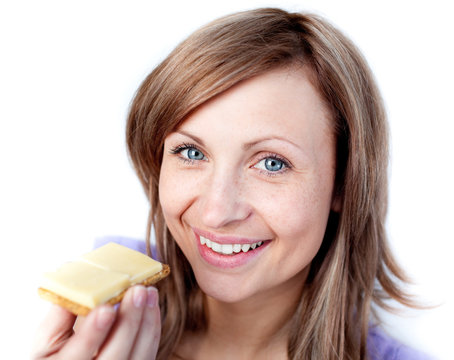 Beautiful woman eating a cracker with cheese