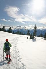 Women in the winter snow shoe hiking.