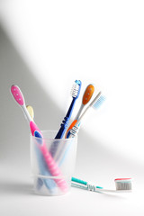 Toothbrushes in a glass