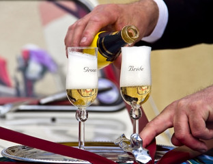 Wedding - Pouring Champagne to Groom and Bride Glasses