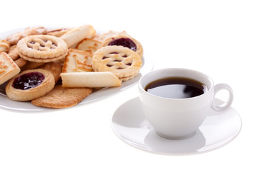 Cup of coffee and cookies on a plate