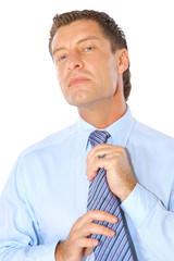Portrait of a businessman fixing necktie