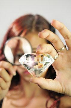 Girl Examining a Diamond
