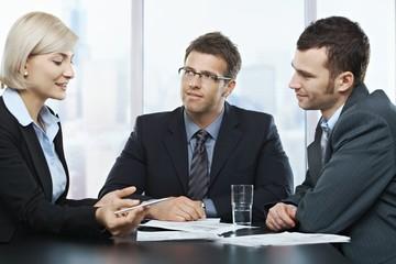 Businessmen listening to businesswoman