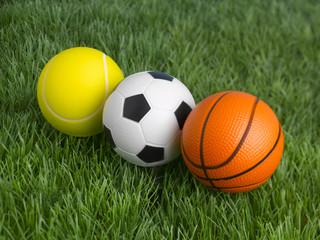 three balls on the lawn