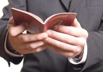 men's hand showing  passport in a customs control